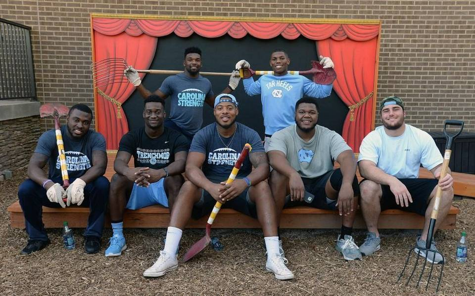 Nazair Jones and teammates in the secret garden