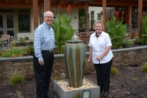 Woody and Jean Durham with their fountain at the House